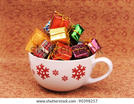 Christmas gift and cup on Vintage christmas background - stock photo