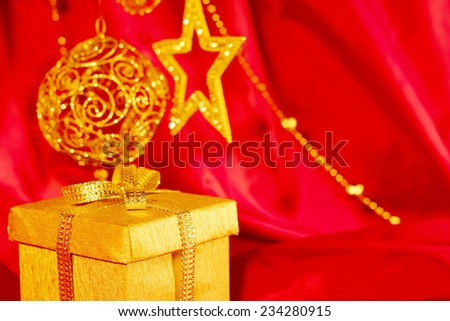 Christmas gift and decor on red fabric background