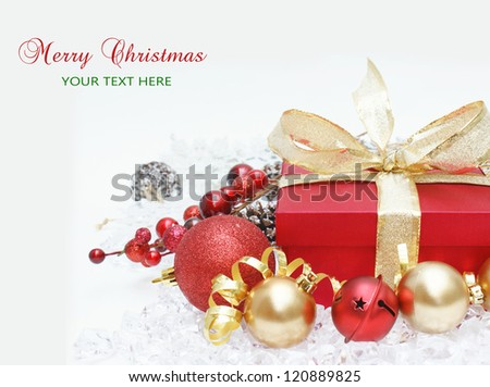 Christmas gift background with berries, bells and baubles