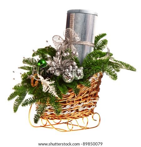 Christmas gift basket on white background - stock photo