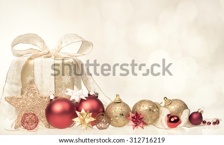 Christmas gift box and balls on a blurred background with copy space. - stock photo