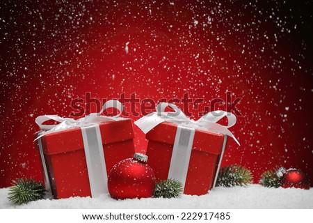 Christmas gift box and balls on snow. - stock photo