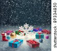 Christmas gift box and big snowflake on snow. Christmas concept Background - stock photo