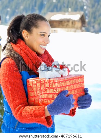 Christmas gift box and woman in winter outdoors. Christmas gift box concept nature
