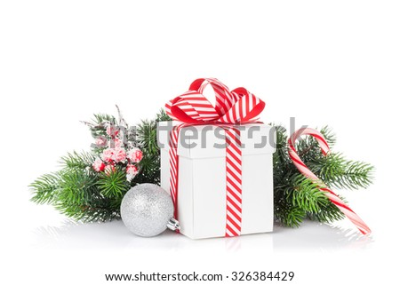 Christmas gift box, bauble and candy cane. Isolated on white background - stock photo