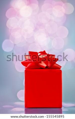 Christmas gift box on blue background - stock photo