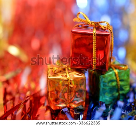 Christmas gift box on colourful background