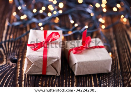 Christmas gift box on gold background - stock photo