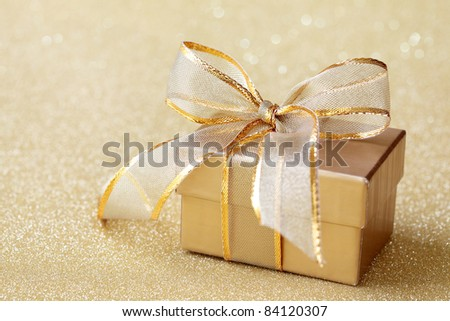 Christmas gift box on golden background - stock photo