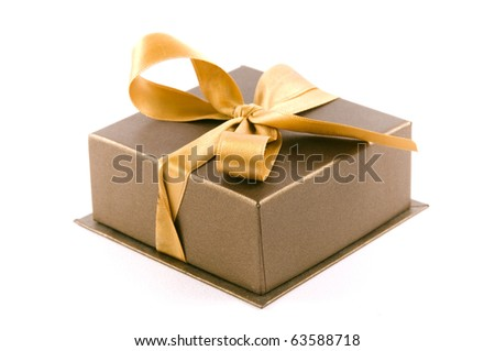 Christmas gift box on white background, with golden ribbon - stock photo