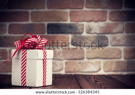 Christmas gift box on wooden table. View with copy space. Toned - stock photo