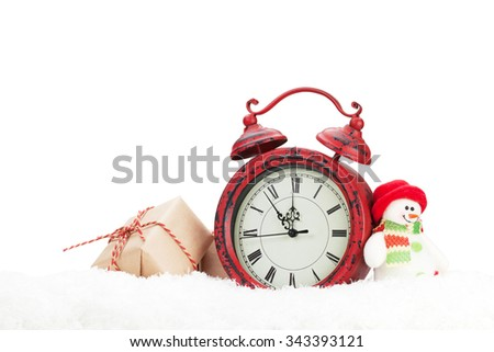 Christmas gift box, snowman toy and alarm clock in snow. Isolated on white background - stock photo