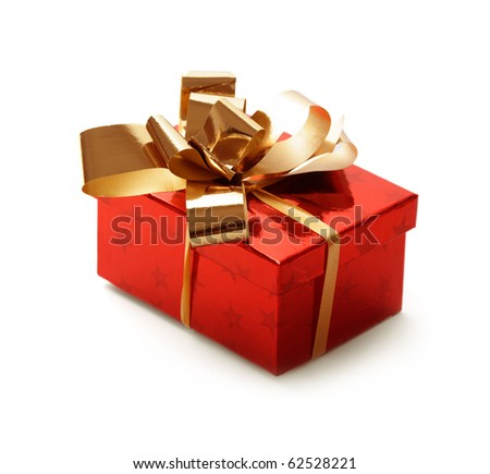 christmas gift box tied with a gold ribbon bow on white background - stock photo