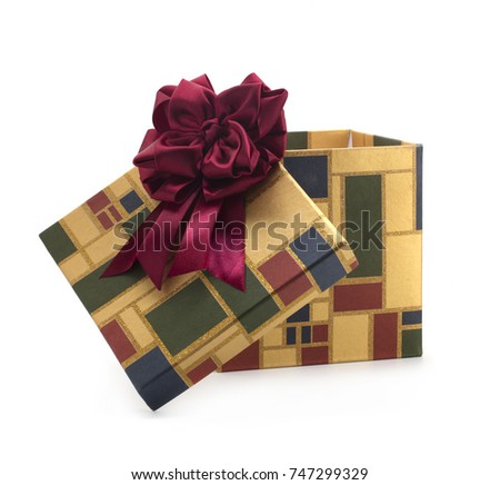 Christmas gift box with a red bow on a white background