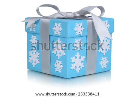 Christmas gift box with bow and snow flakes for gifts in winter isolated on a white background - stock photo