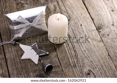 Christmas gift box with candle and star - stock photo