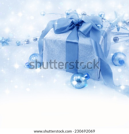 Christmas gift box with christmas balls. - stock photo
