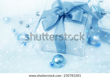 Christmas gift box with christmas balls. - stock photo