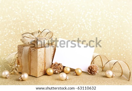 Christmas gift box with christmas balls and blank note - stock photo
