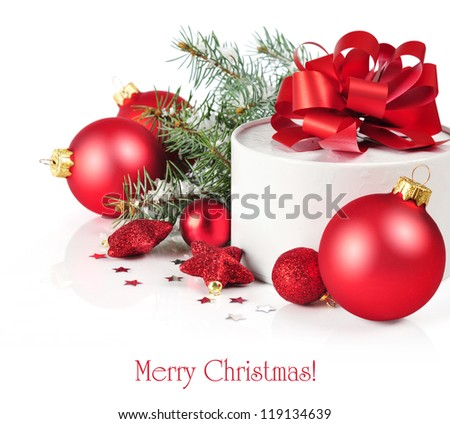 Christmas gift box with decorations and branch fir tree - stock photo