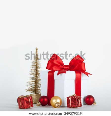 Christmas gift box with decorations on white background.