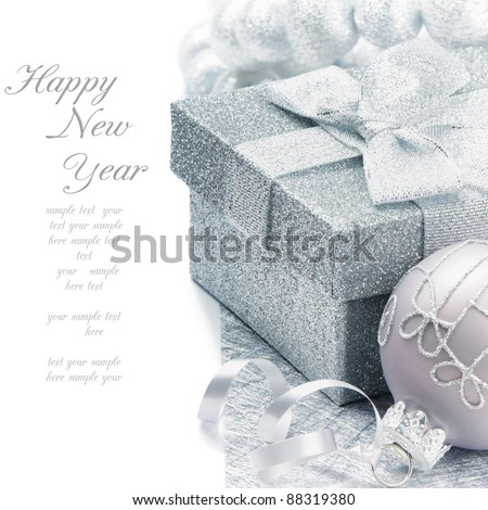 Christmas gift box with festive decoration in silver tone - stock photo
