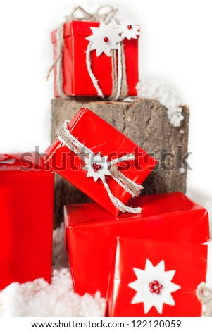 Christmas gift box wrapped in red paper. Decoration in studio on white background. Series.