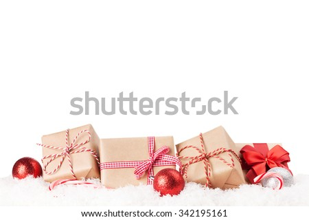 Christmas gift boxes and decor in snow. Isolated on white background - stock photo