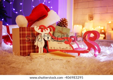 Christmas gift boxes and decoration on the soft carpet, indoor - stock photo