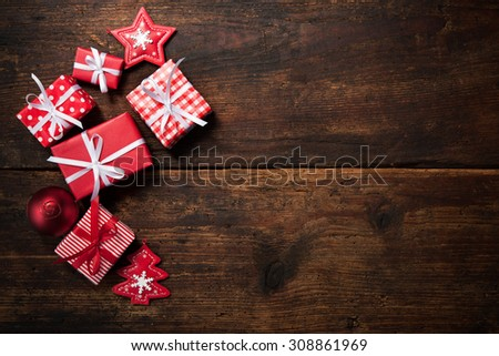 Christmas gift boxes and decoration over grunge wooden background - stock photo