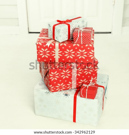 Christmas gift boxes delivered to house front door - stock photo