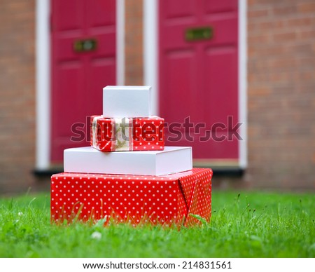 Christmas gift boxes delivered to house front door. Early Christmas preparation concept. - stock photo