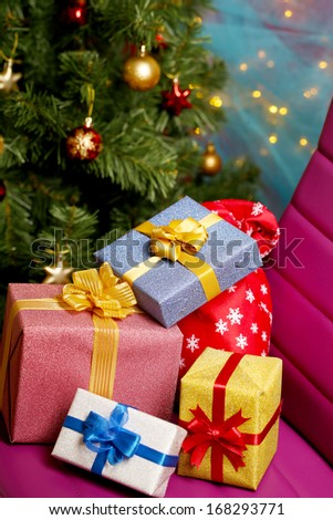 Christmas gift boxes on Christmas tree background - stock photo