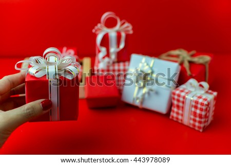Christmas gift boxes with red background.holiday presents - stock photo