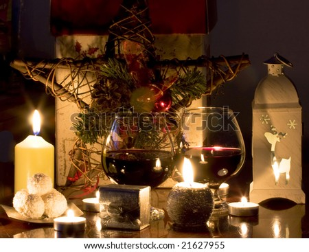 Christmas gift, candles and red wine - stock photo