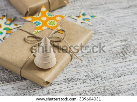 Christmas gift, Christmas decoration - wooden Christmas tree on a light wooden surface - stock photo