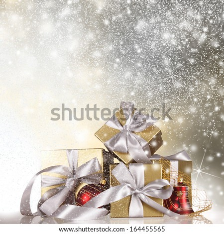Christmas gift covered with snow - stock photo