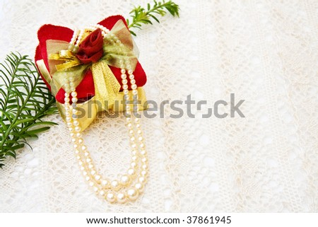 Christmas gift decoration on old lace