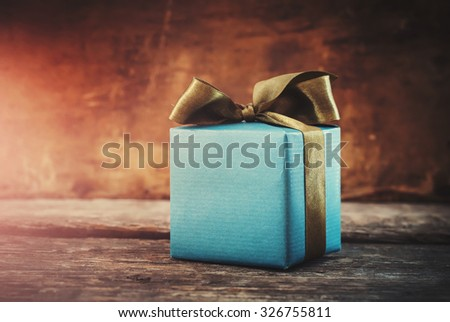 Christmas Gift. Festive Box on Wooden Background. Toned - stock photo
