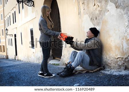 Christmas gift for homeless man - stock photo