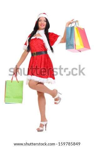 Christmas, gift. Happy woman with shopping bags.