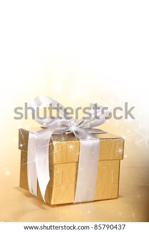Christmas gift in golden theme - stock photo