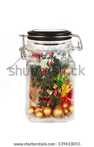 Christmas gift  inside glass bottle, abstract concept of savings an nature, isolated on white background