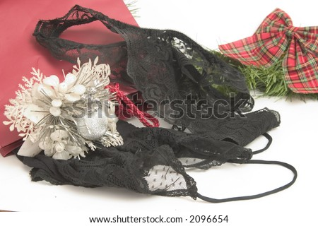 Christmas Gift of Black Lingere for someone's sweetheart - stock photo
