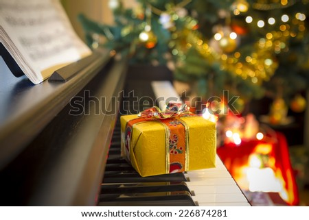 Christmas gift on piano. Christmas decoration with gift on piano. - stock photo