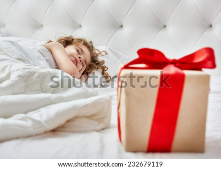 Christmas gift on the bed - stock photo