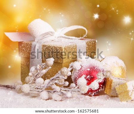 Christmas gift over golden background - stock photo