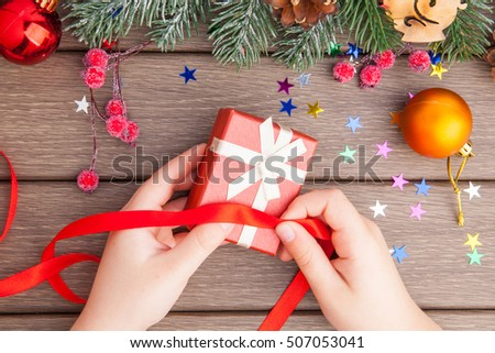 Christmas gift packing in red color on wooden background