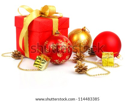 Christmas gift, red box with golden bow and balls, New Year holiday photo