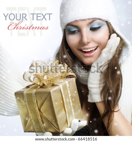 Christmas Gift.Surprised Beauty - stock photo